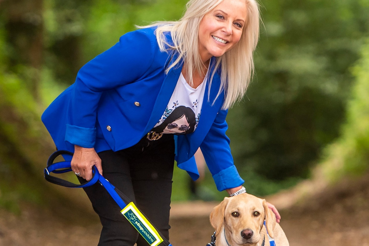Lottery winner trains assistance dog after brother\'s epilepsy death