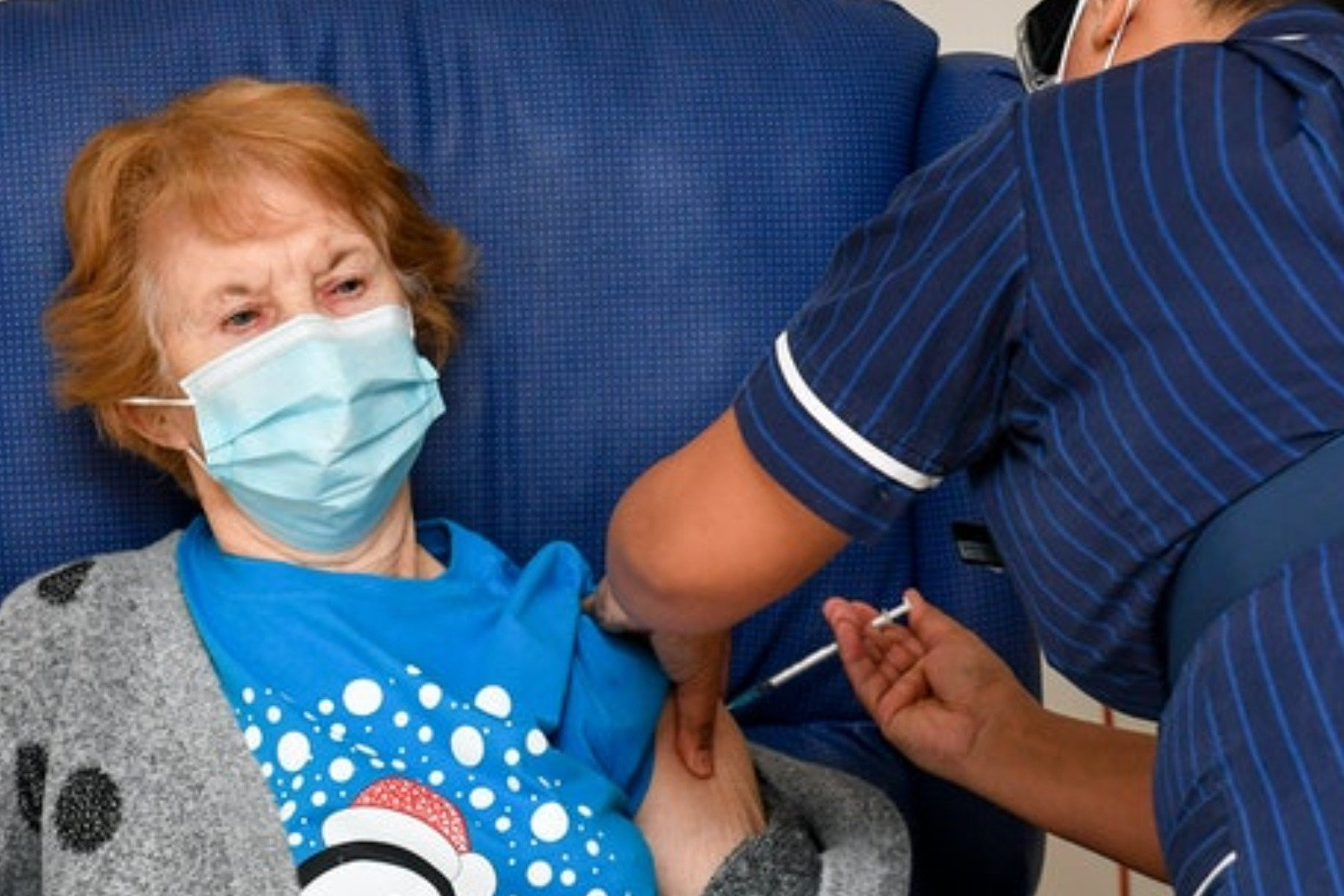 UK begins mass coronavirus vaccination rollout as 90-year-old gets jab