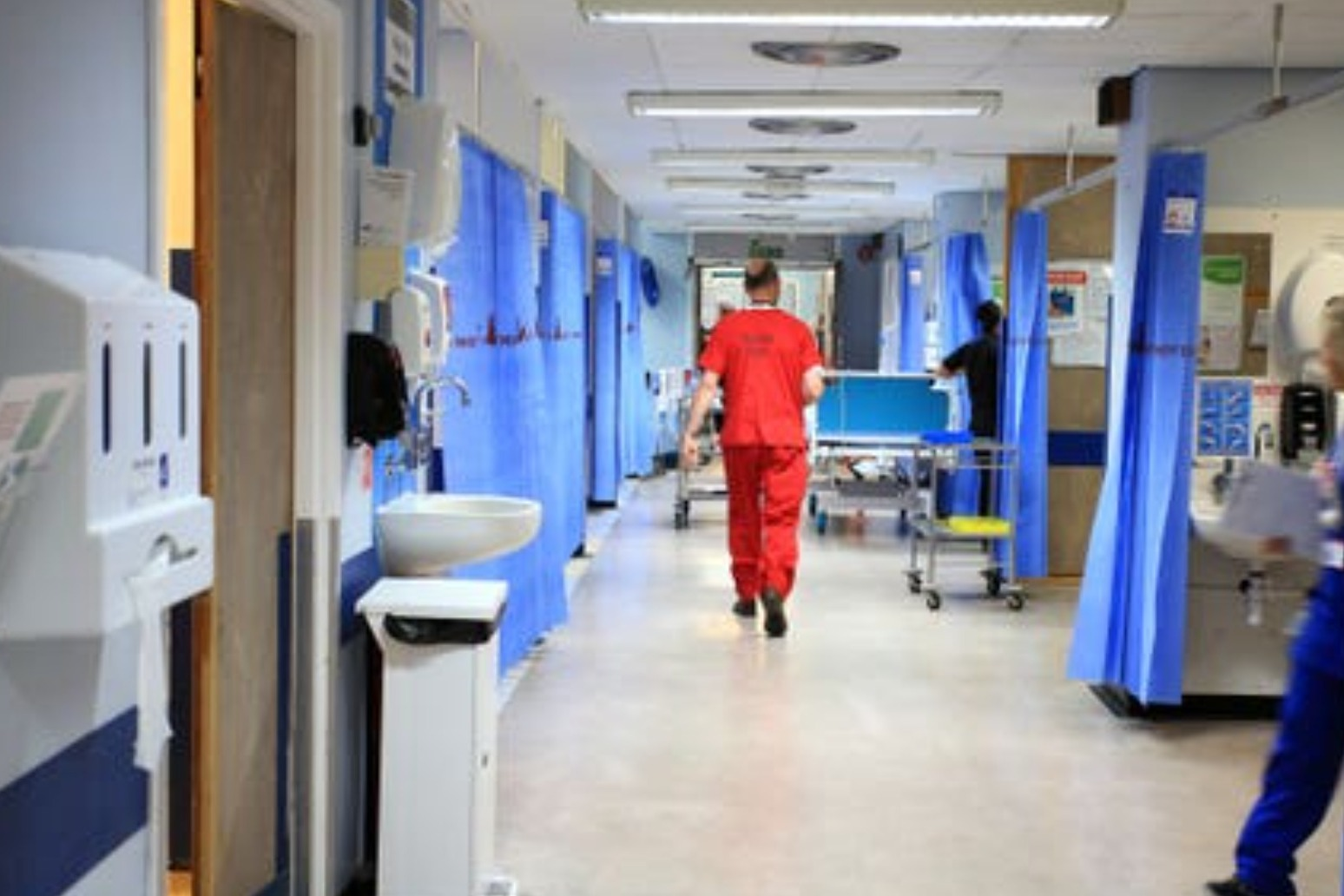 Government under pressure to increase NHS pay after Scotland offer