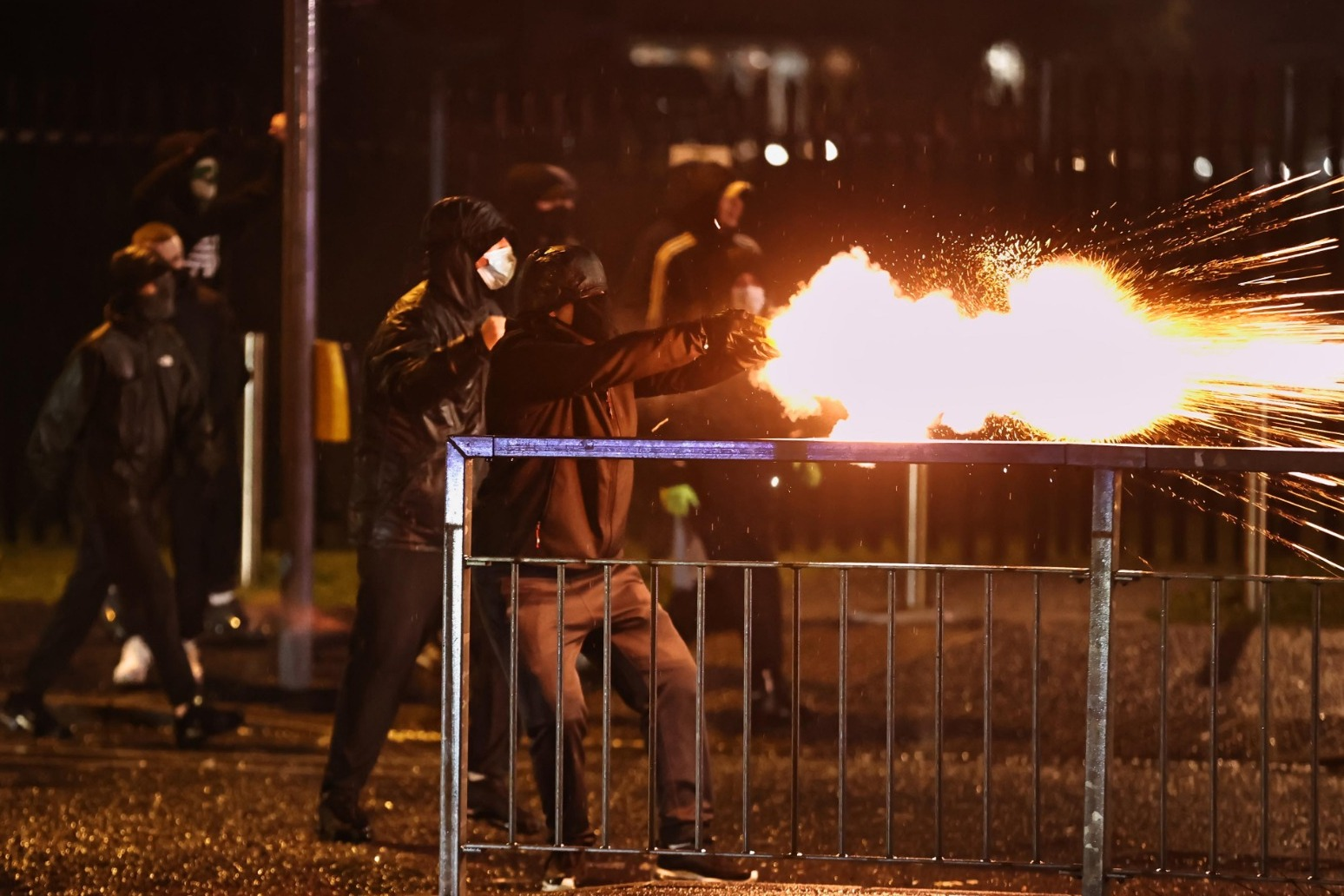 Police blast rioters with water cannon as violence flares again in N Ireland