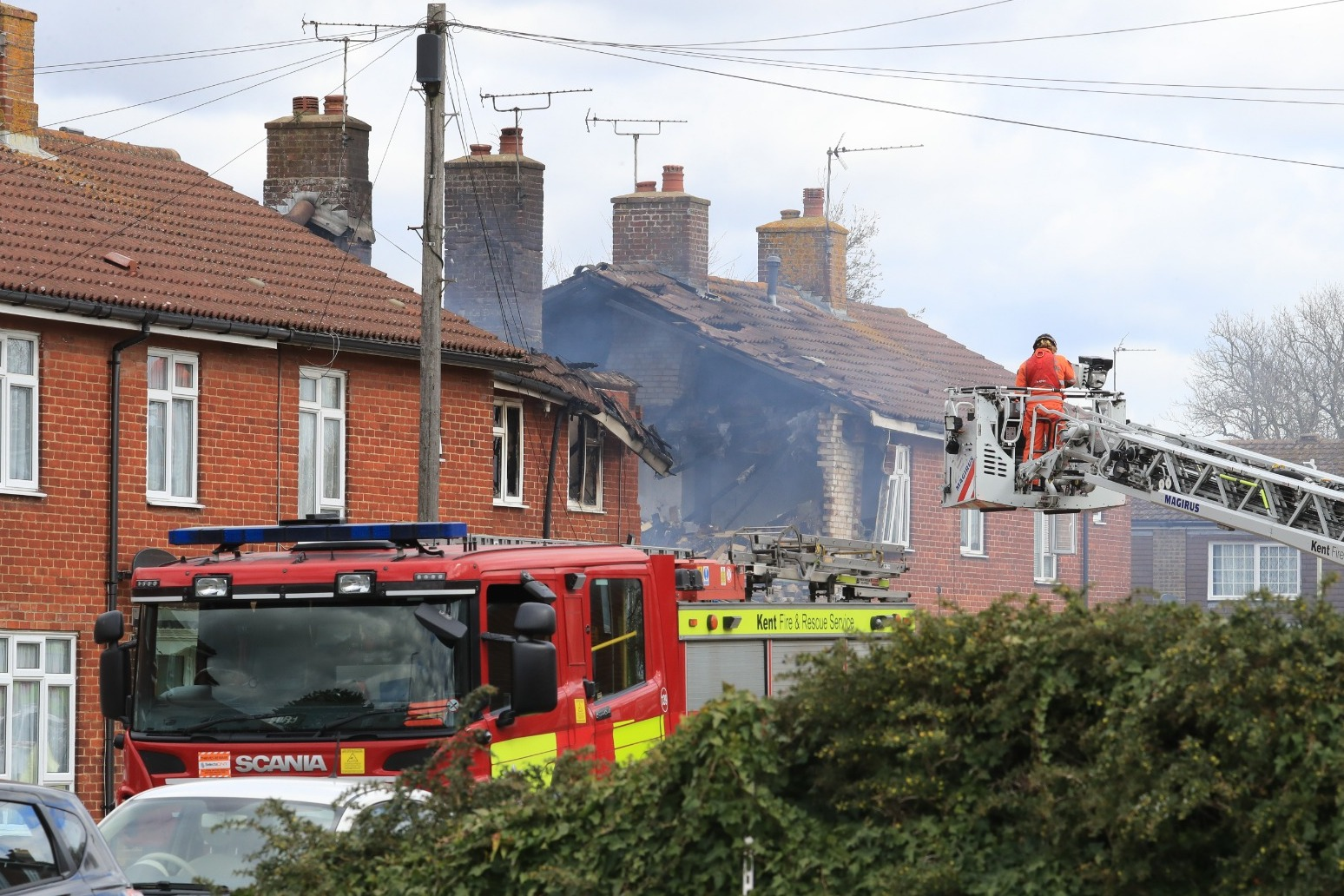 Firefighters tackle blaze following explosion at house