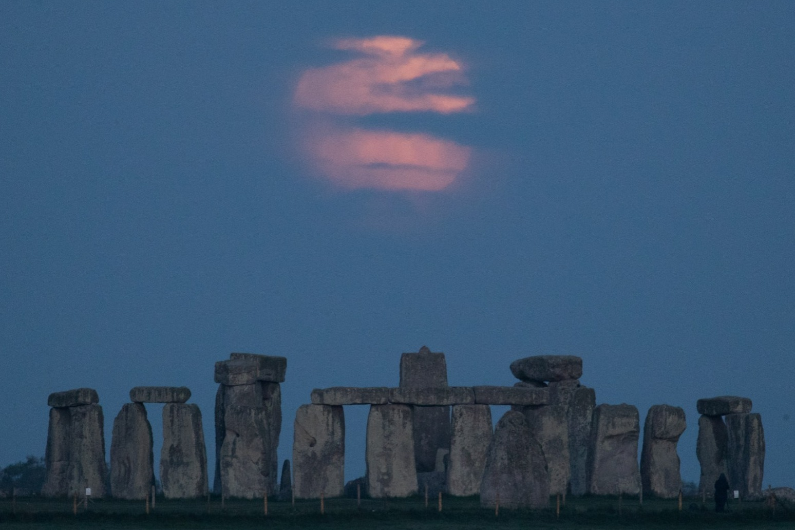 Supermoon obscured by clouds as it graces night sky