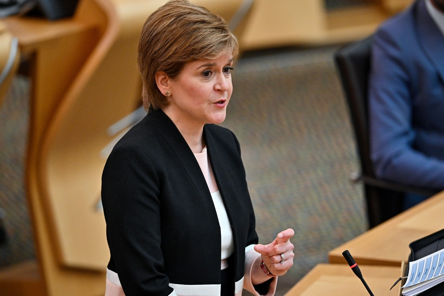 Restrictions need to be eased with 'care and caution', Sturgeon says
