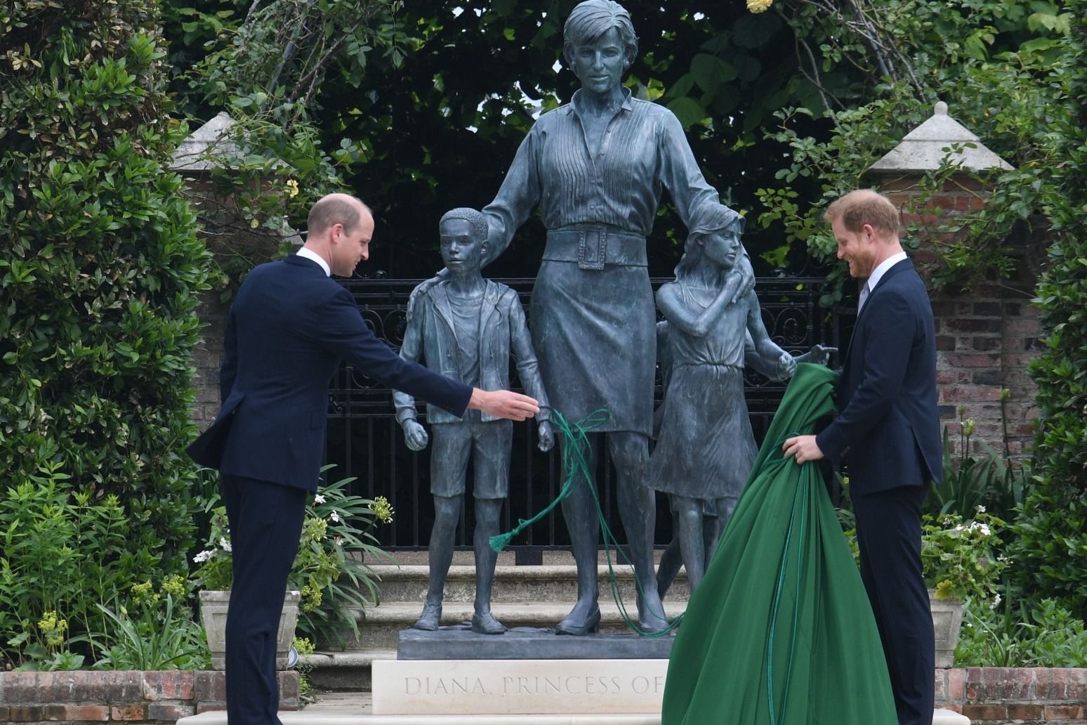 William and Harry put on united front at unveiling of Diana statue