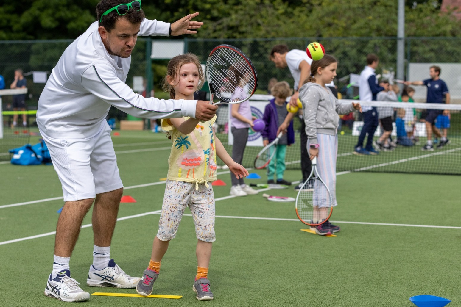 Hundreds of people gather for Thank You Day event at Wimbledon.