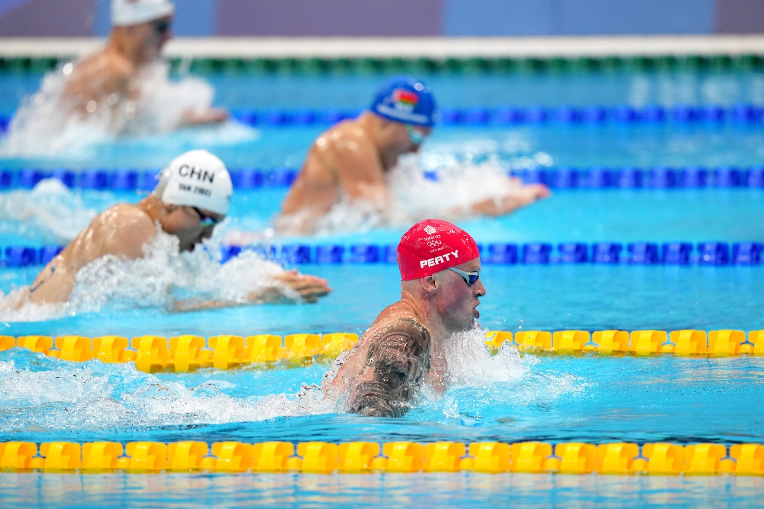 Adam Peaty eases into 100m breaststroke final as he aims to retain Olympic title