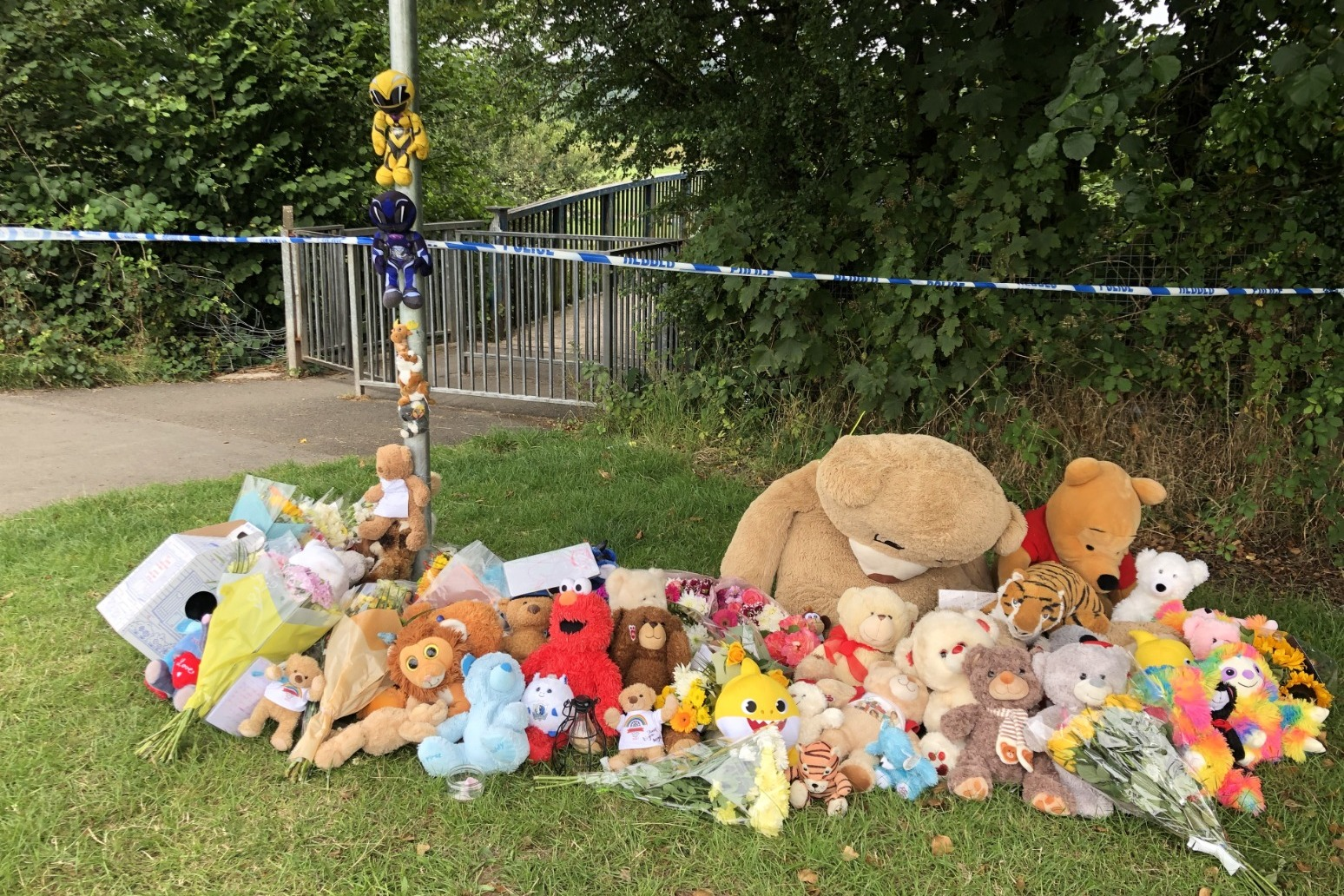 Tributes to boy, 5, found dead in river as three held on suspicion of murder