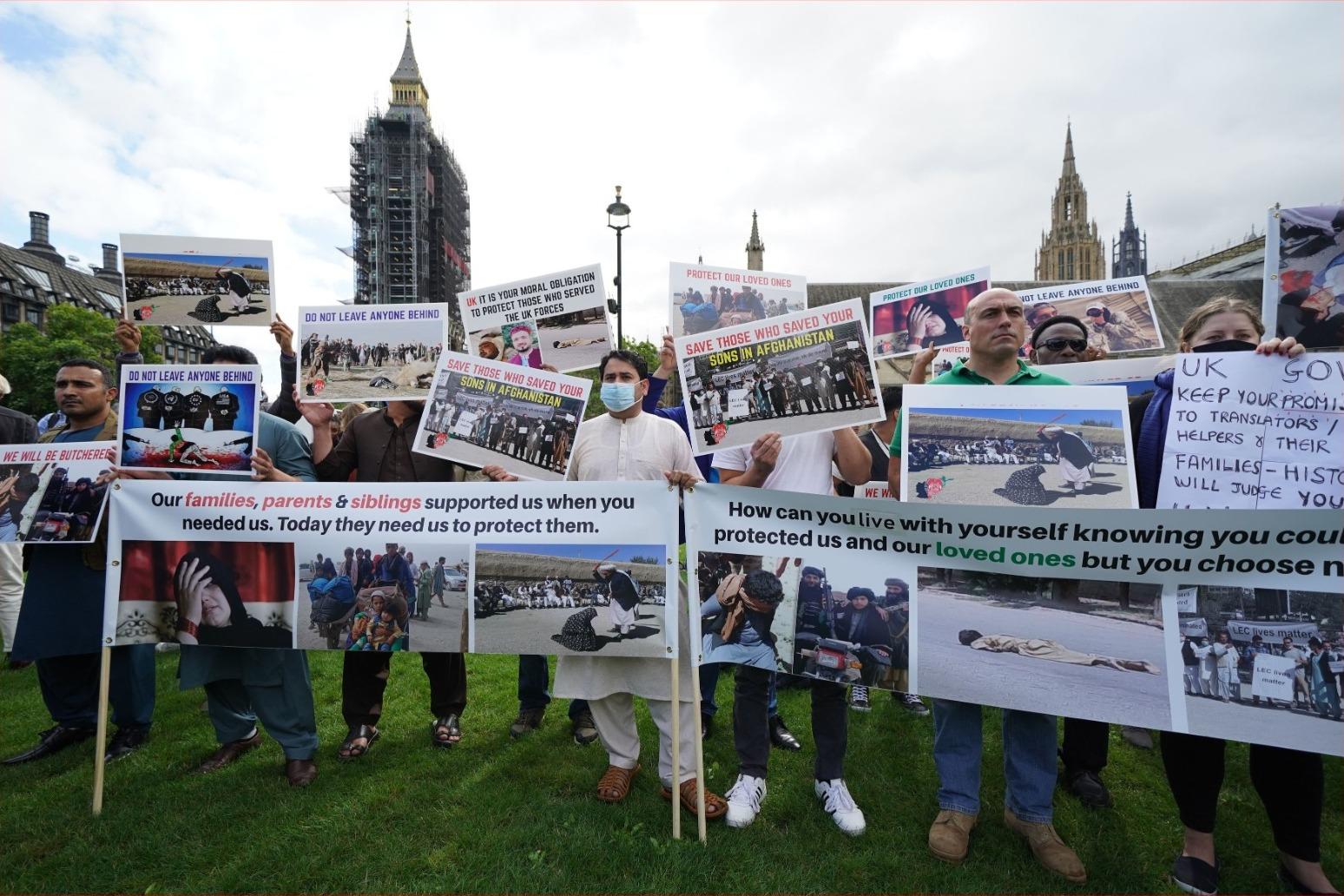 Former translators demand protection for Afghans at Parliament Square protest