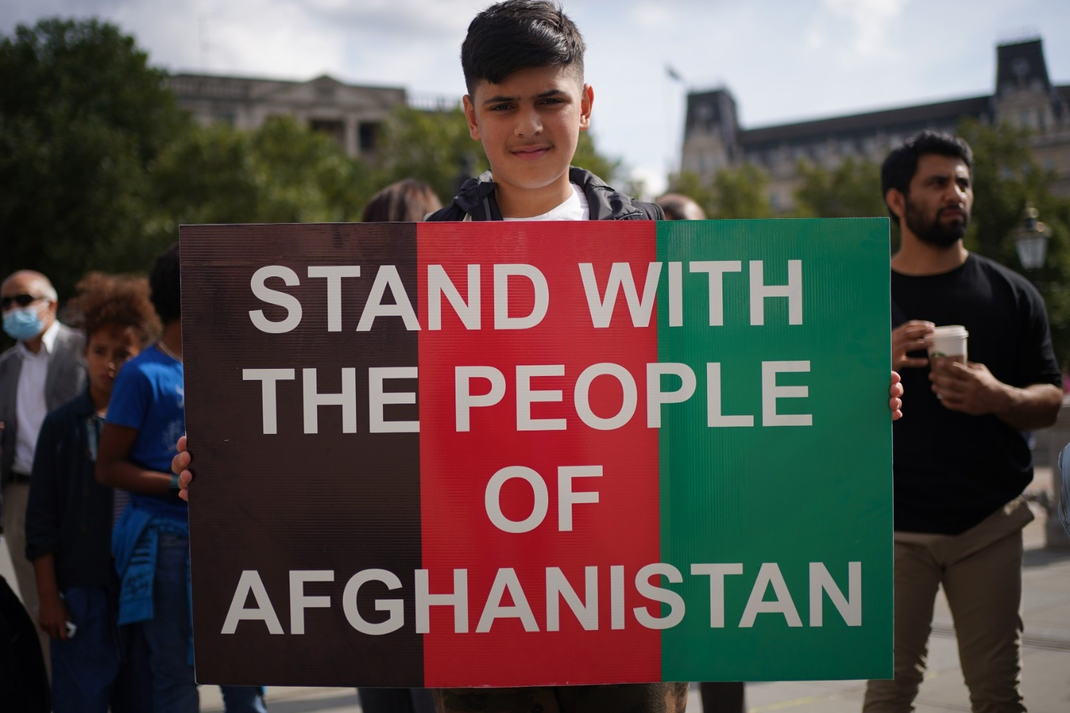 Protesters urge world not to ignore plight of Afghans.