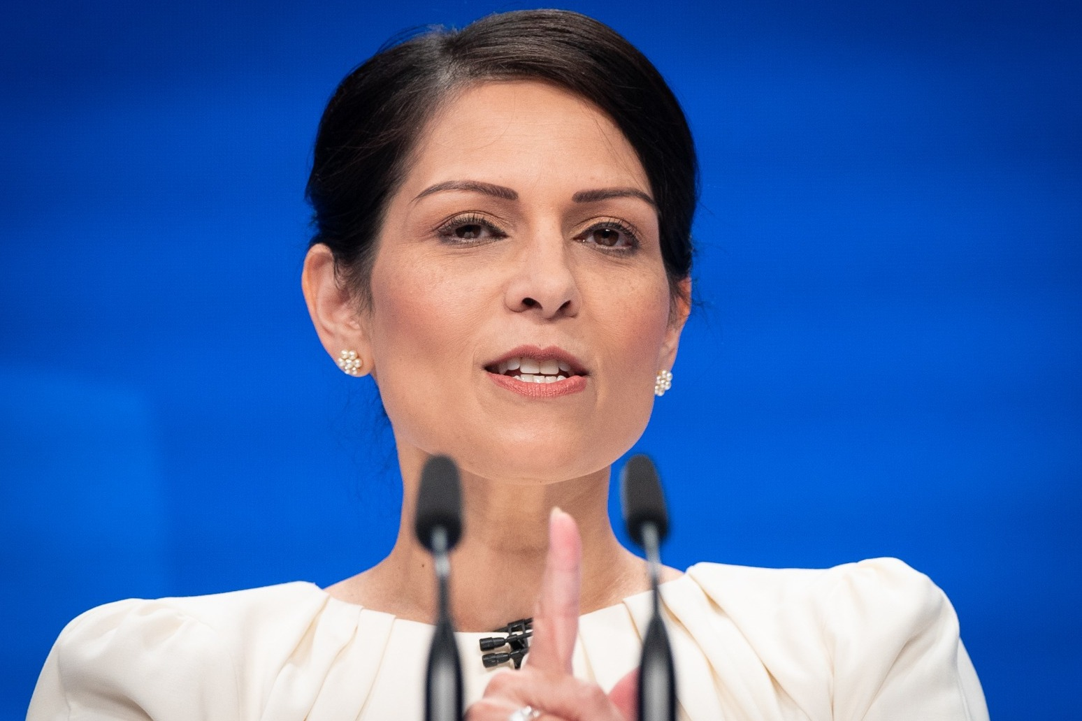 Priti Patel urged to tackle male violence after backing phone service for women