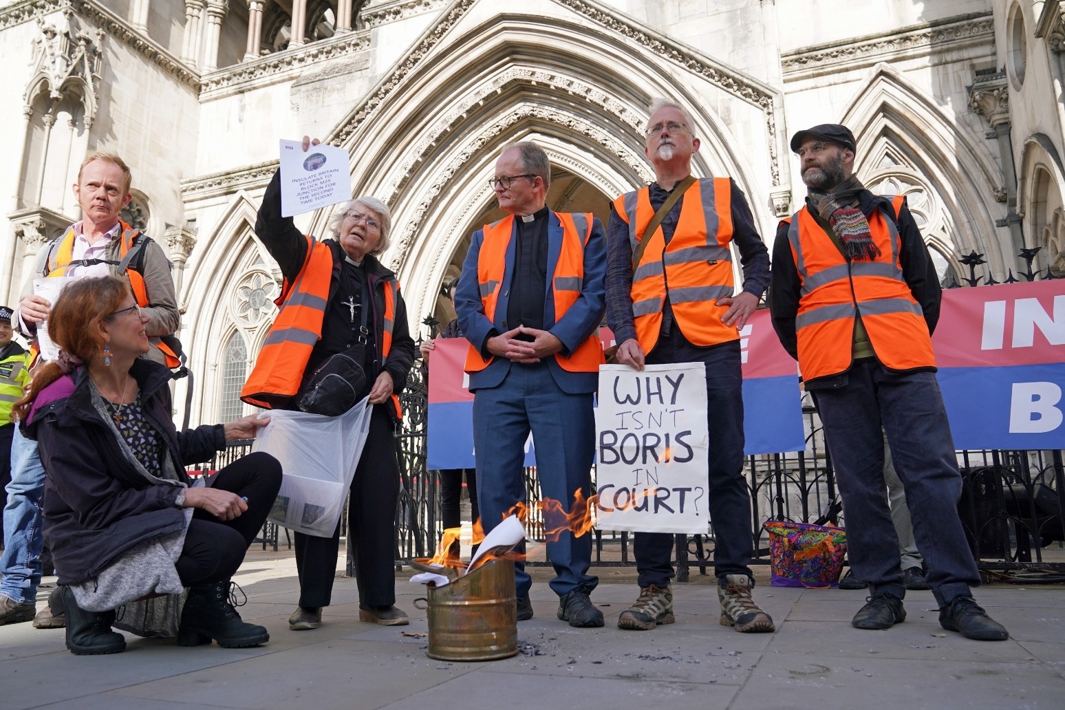 Insulate Britain protesters burn injunctions outside court as ban extended