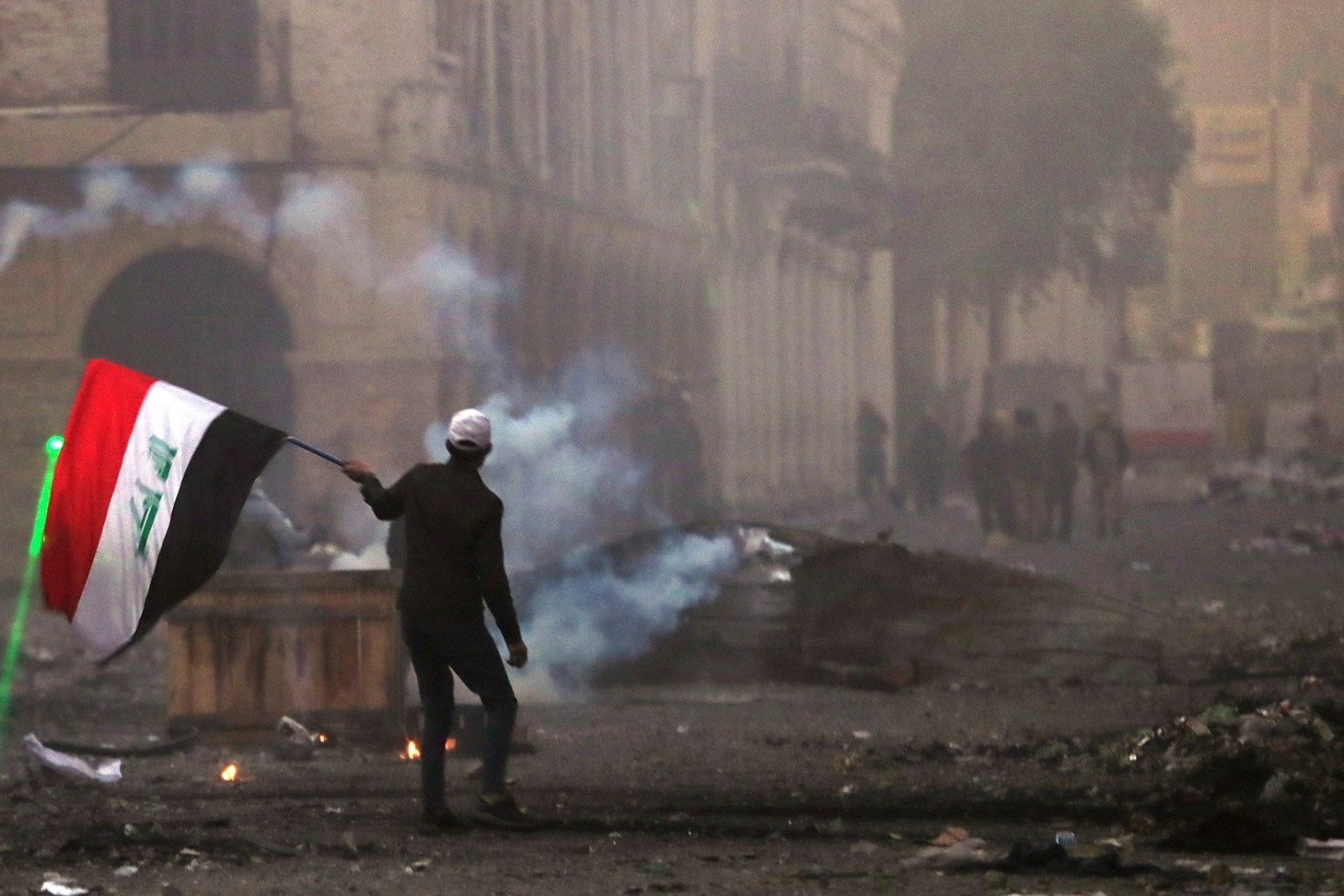 PROTESTERS KILLED AS CLASHES CONTINUE IN BAGHDAD