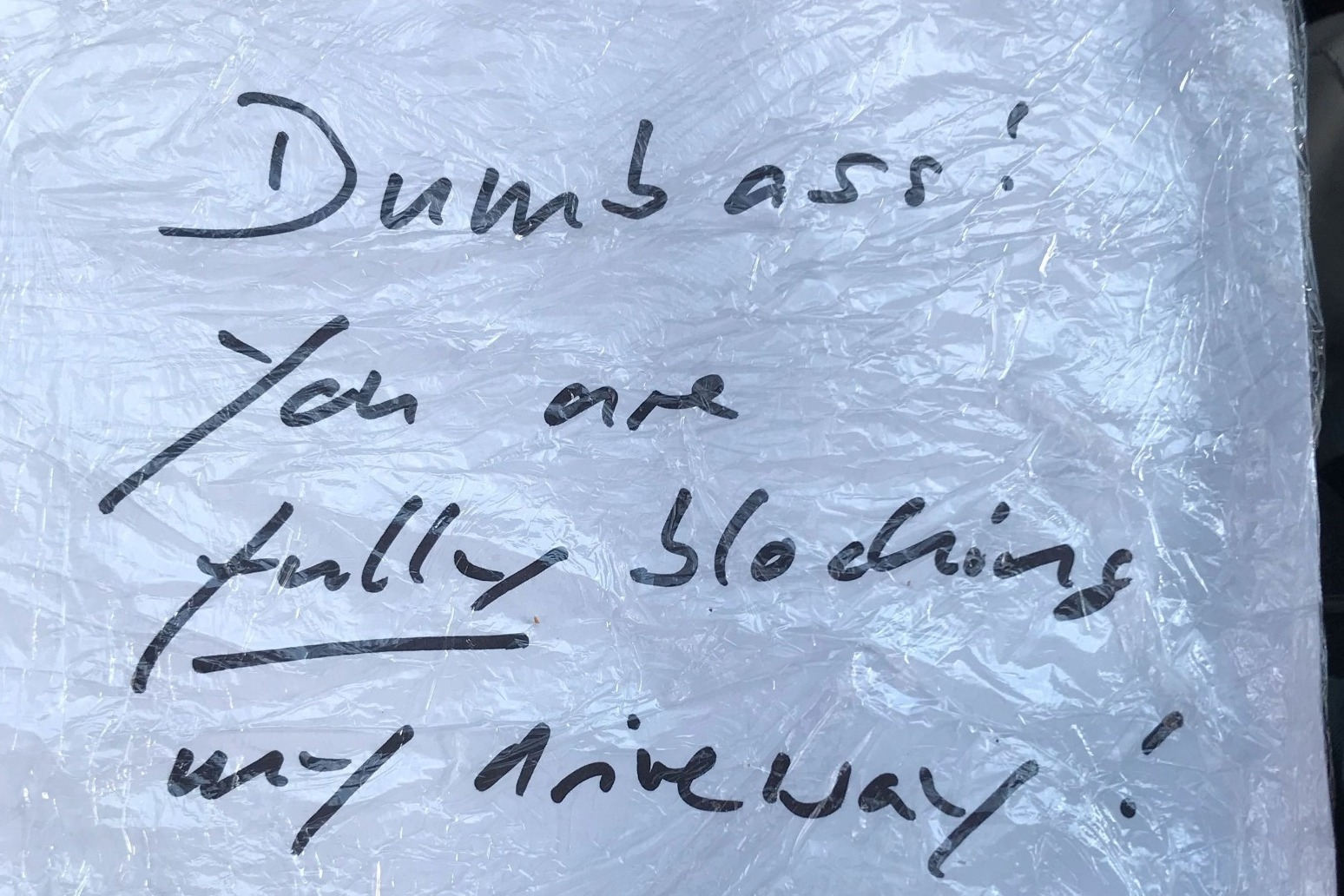 DISGRUNTLED RESIDENT LEAVES NOTE INSULTING PARAMEDICS FOR BLOCKING DRIVEWAY