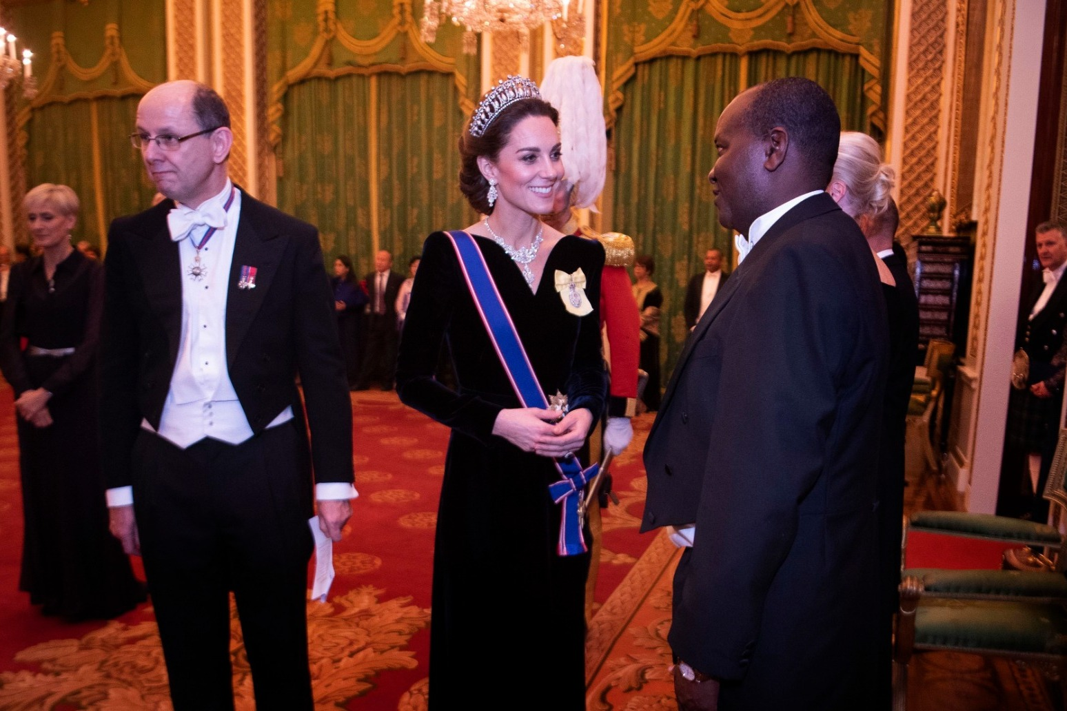 KATE OPTS FOR LOVER\'S KNOT TIARA AT EVENING RECEPTION