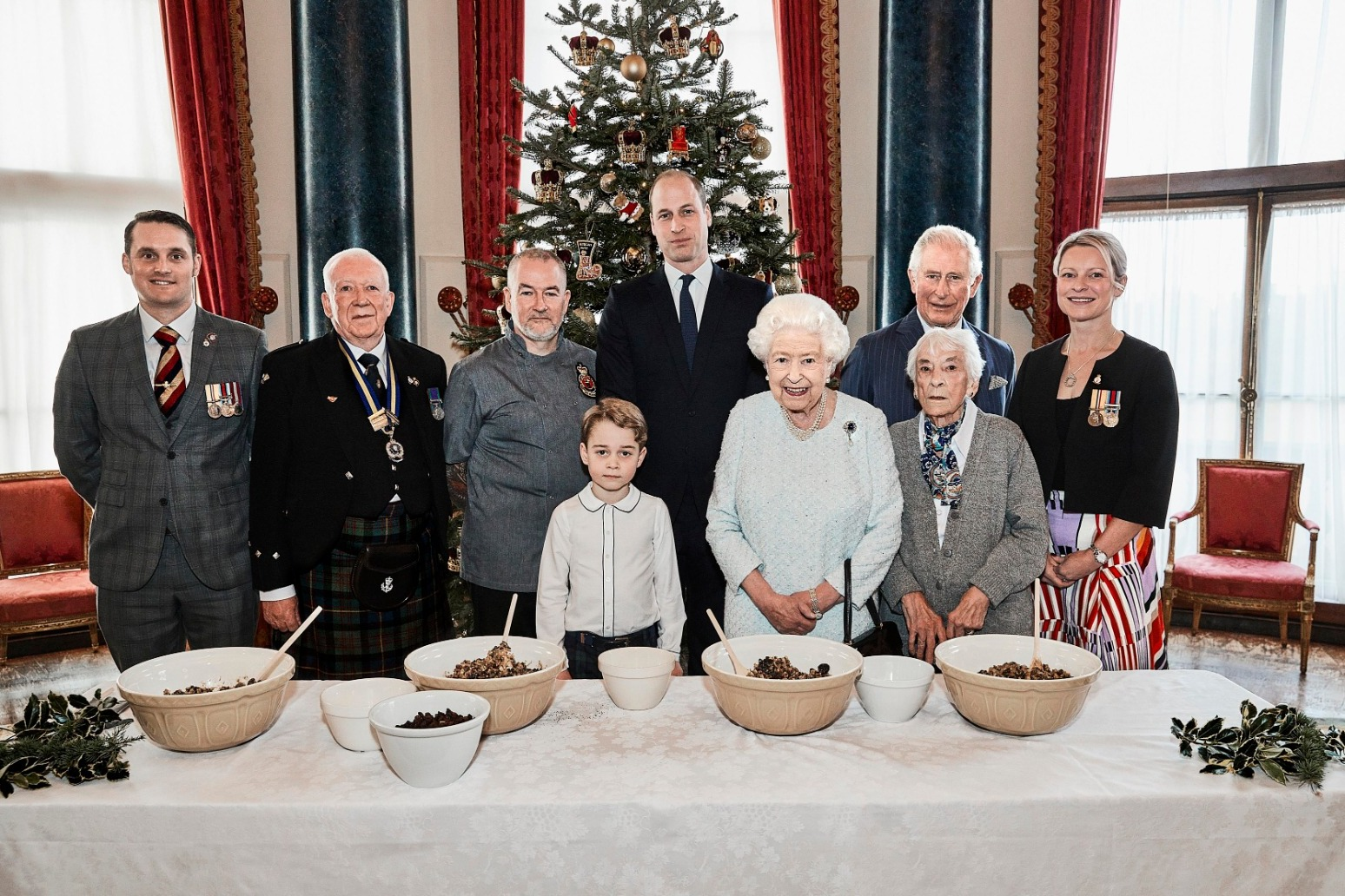 QUEEN JOINS FUTURE GENERATIONS AND BAKES FESTIVE TREATS AT BUCKINGHAM PALACE