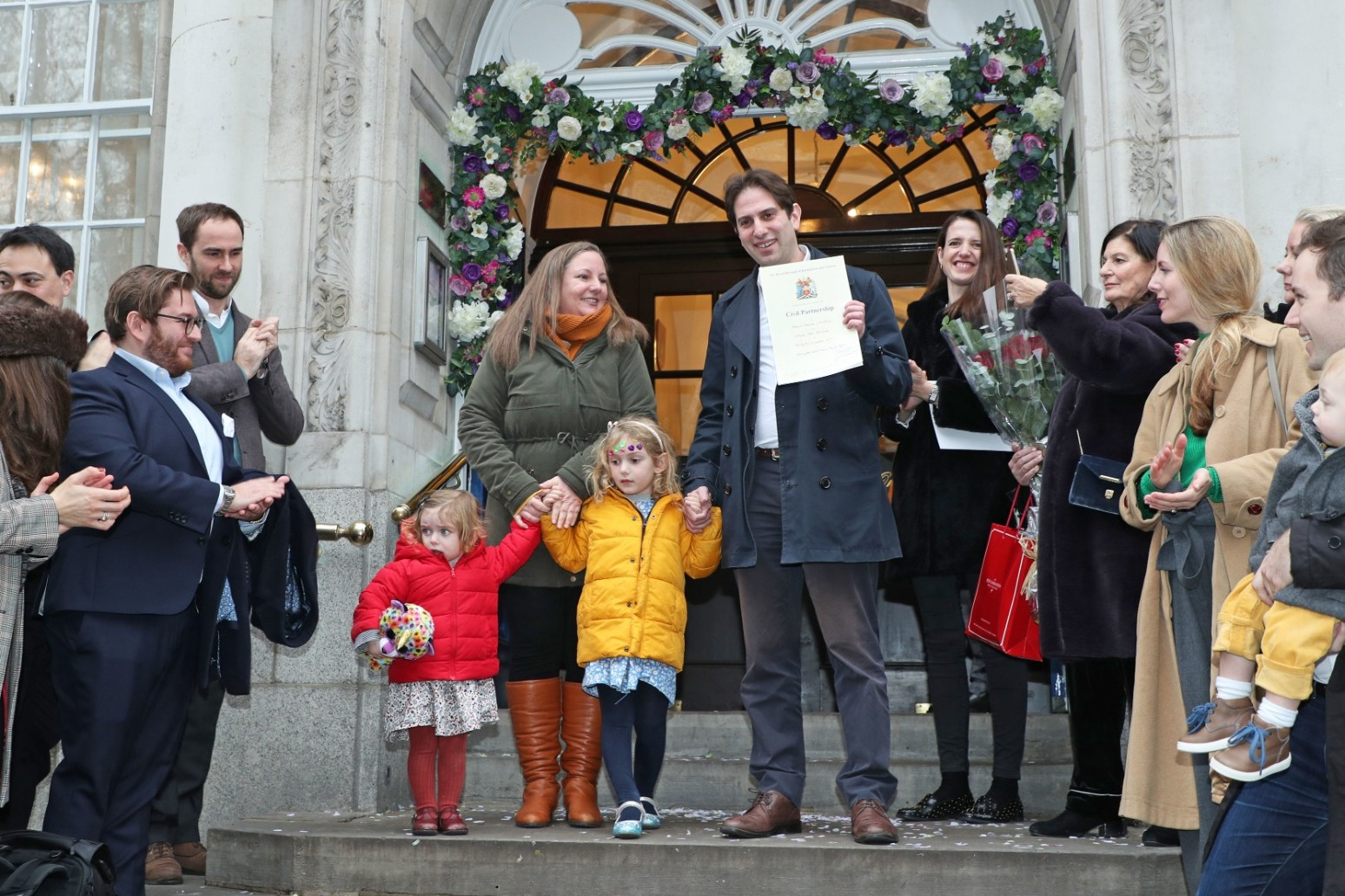 COUPLES MAKE HISTORY IN FIRST MIXED-SEX CIVIL PARTNERSHIPS