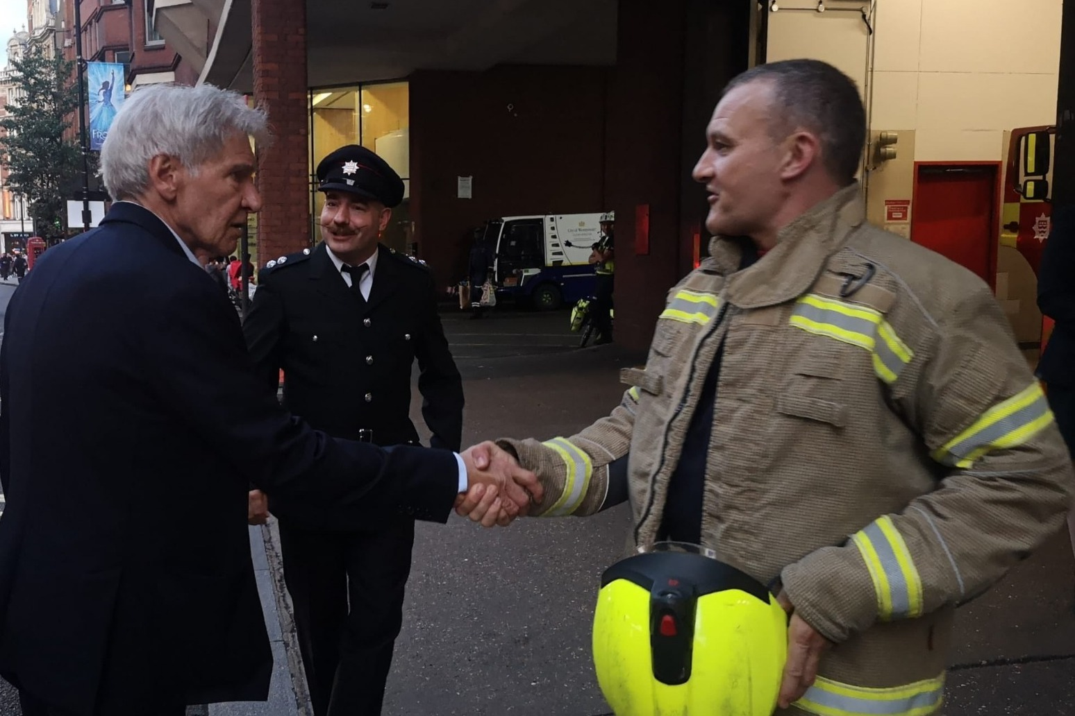 Retiring firefighter receives congratulations from Harrison Ford