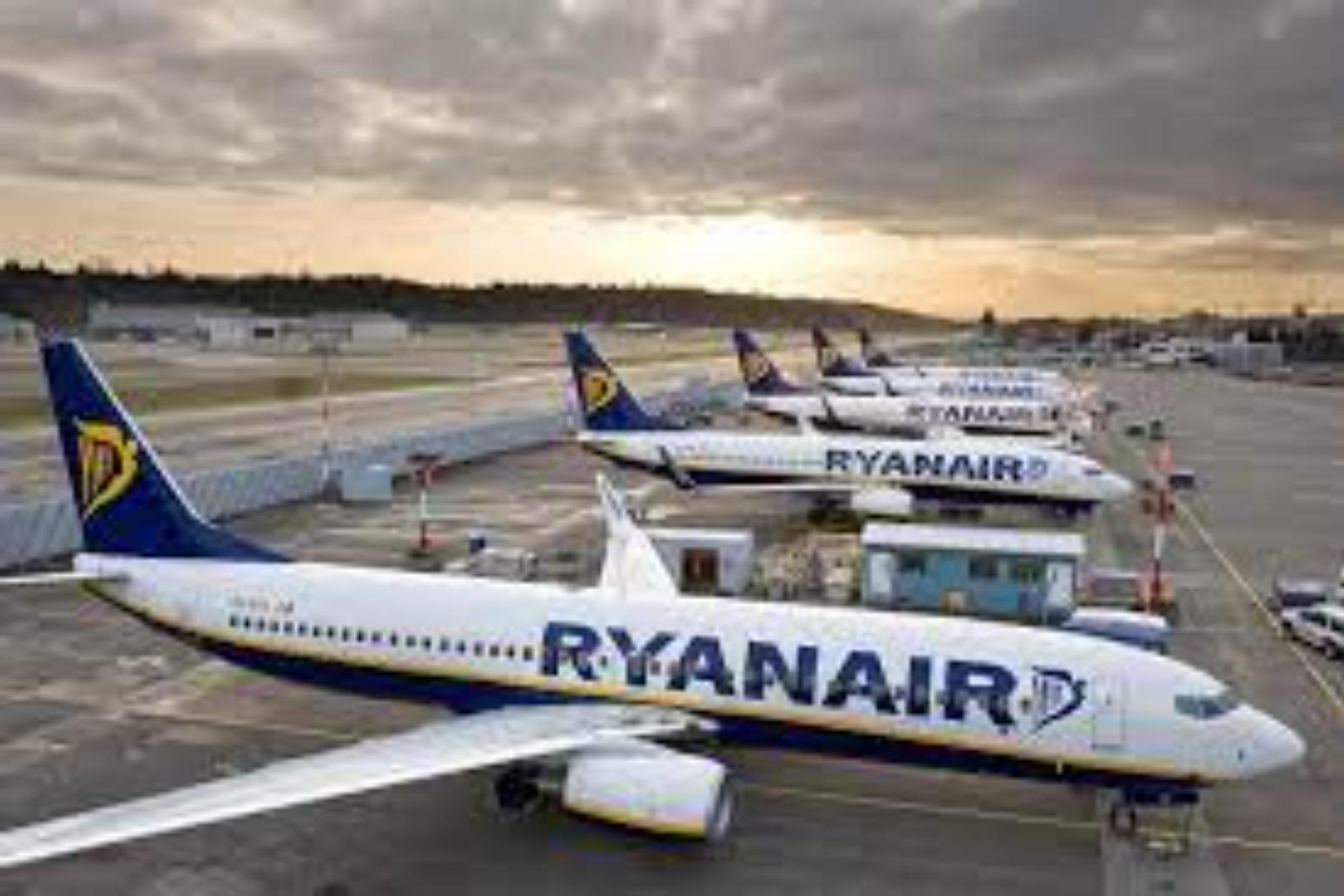 Ryanair boss warns of 'dramatically higher' air fares next summer.