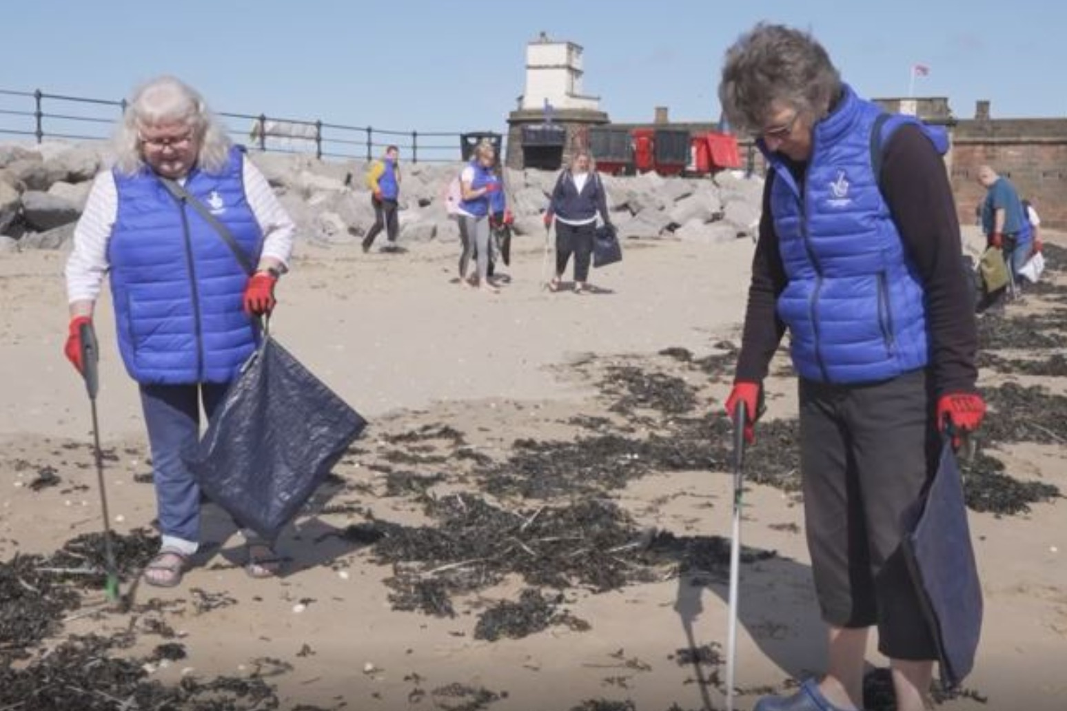 Life's a beach for lottery winners in charity clean-up
