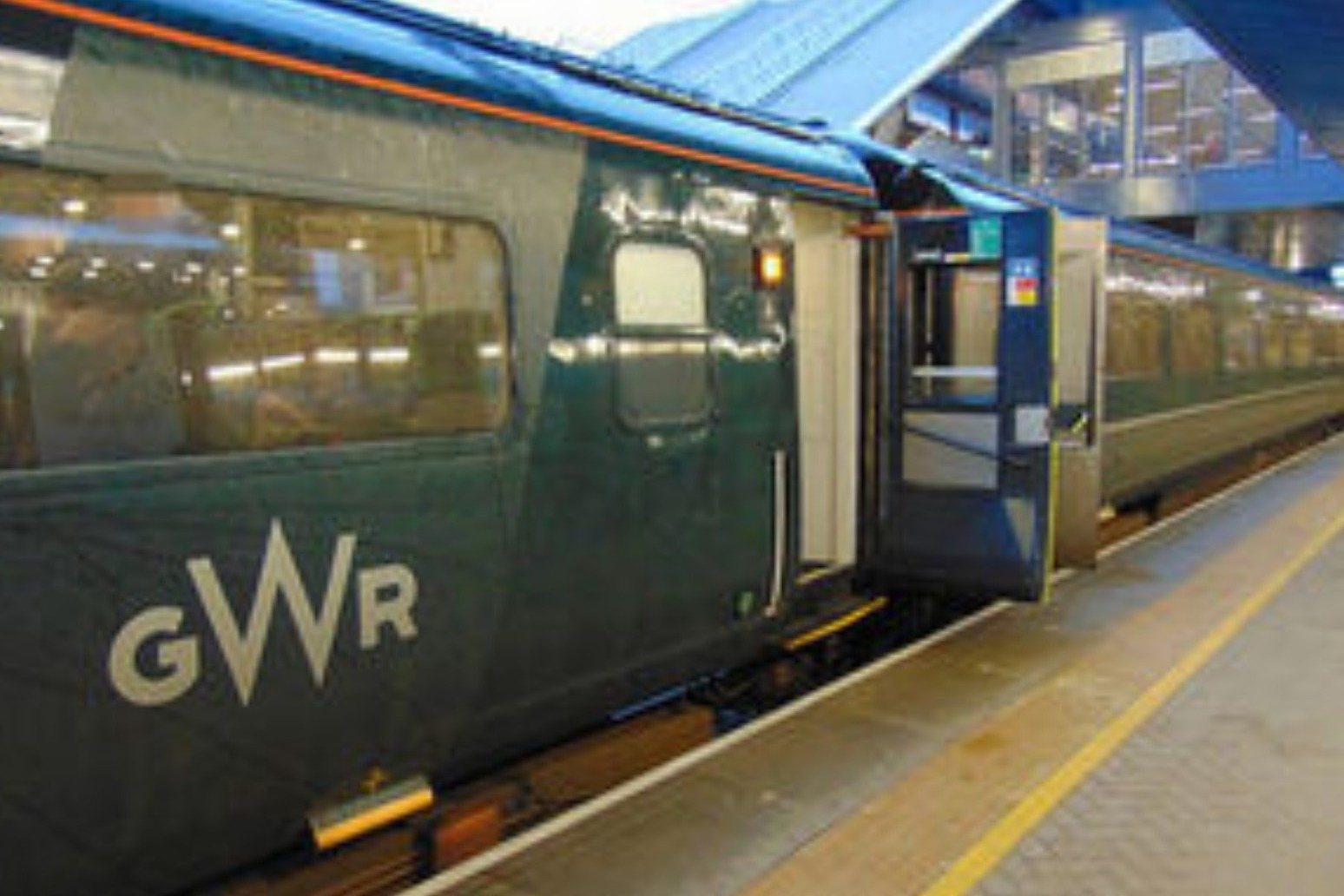 WOMAN DIED LEANING FROM TRAIN WINDOW BELOW INADEQUATE WARNING SIGN - REPORT
