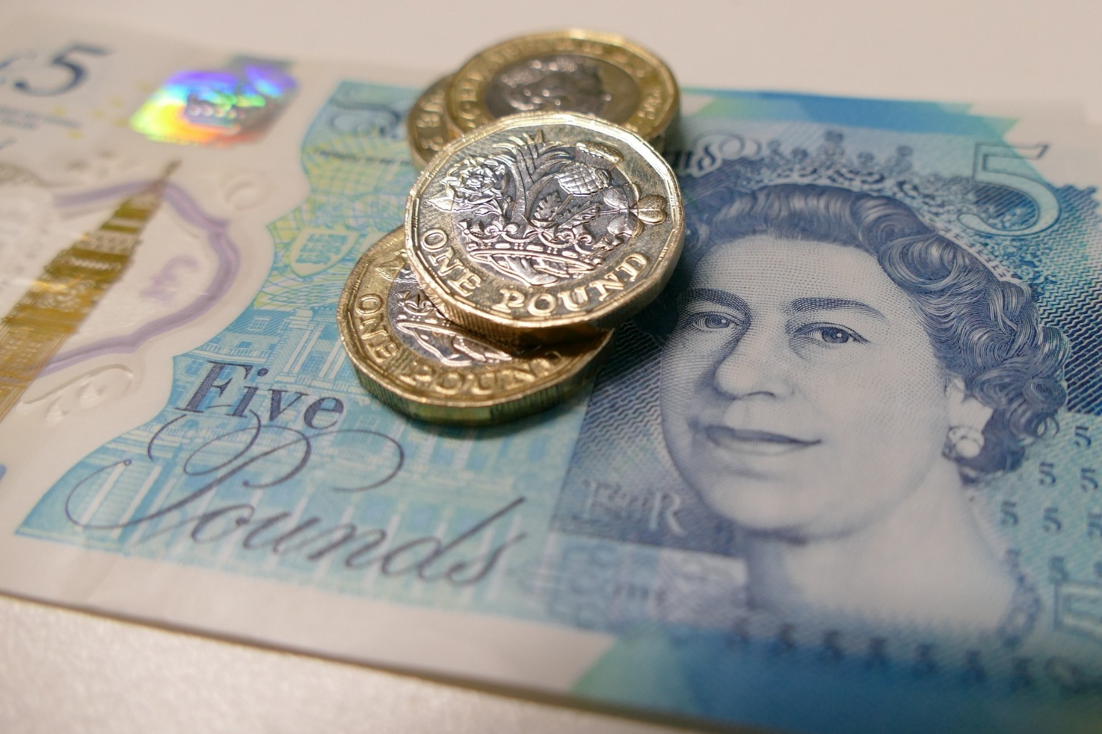 Sterling revisits 2-year lows as UK economy shrinks