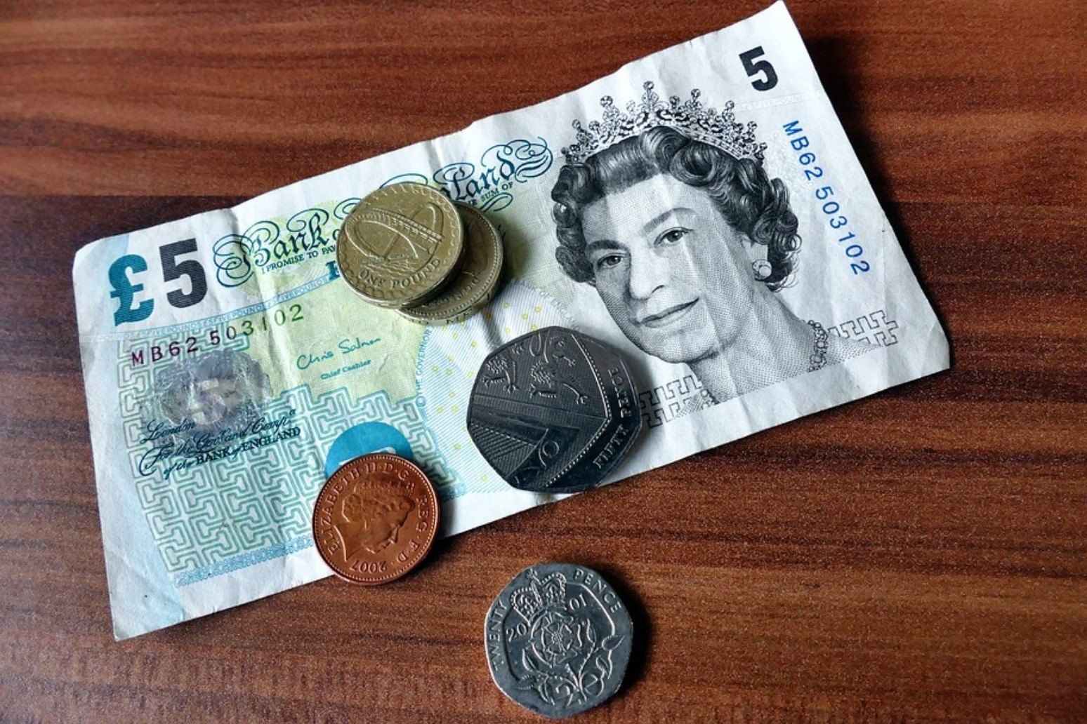 UK pay growth at six-month low
