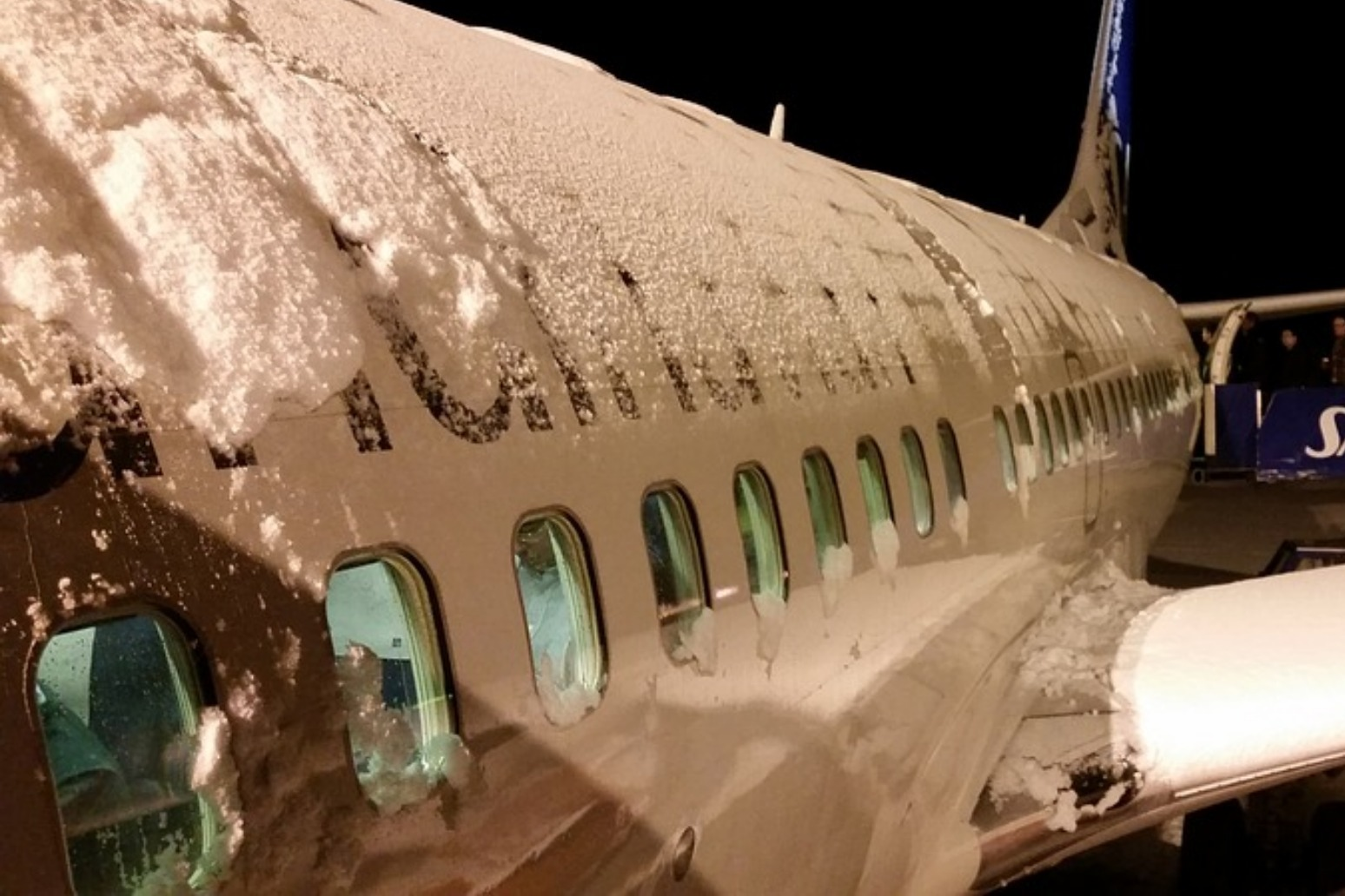 Snow causes widespread disruption across parts of the UK with flights grounded